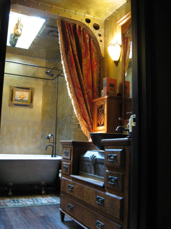 Our steampunk bathroom for Punk rock bathroom decor